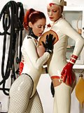Two latex girls in the surgery
