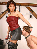 Madame Loreen trains up her slave