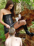 Mistress trains her doggy outdoors