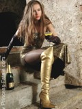 Princess Fatale in evening dress and golden boots