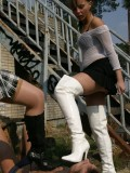 Ladies trample their slaves in boots