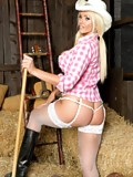 Cowgirl Lucy Zara is working in the barn