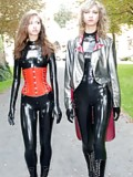 Girls in latex catsuits walking the streets