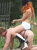 Mistress riding on her slave outdoors