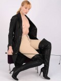 Milf Ariel opens up her long leather trench coat to reveal herself