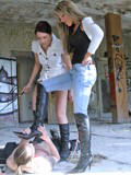 Ladies trampling and whipping a man